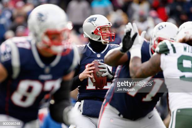 Tom Brady of the New England Patriots looks to pass during the first half against the New York Jets at Gillette Stadium on December 31 2017 in...