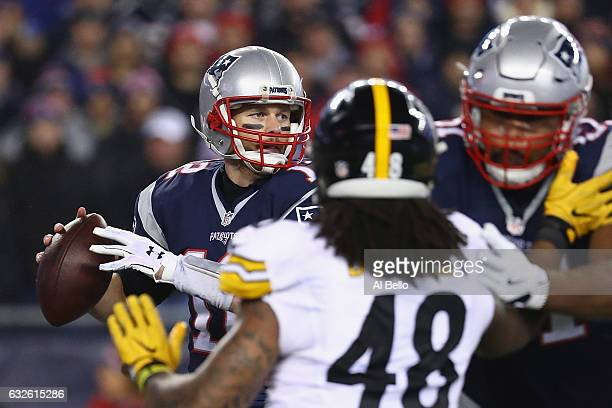 Tom Brady of the New England Patriots looks to pass the ball against the Pittsburgh Steelers in the AFC Championship Game at Gillette Stadium on...