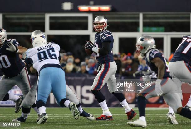Tom Brady of the New England Patriots looks to throw in the first quarter of the AFC Divisional Playoff game against the Tennessee Titans at Gillette...