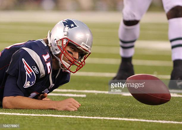 Tom Brady of the New England Patriots loses the ball after being sacked against the New York Jets during their game on September 19, 2010 at the New...