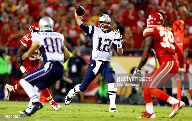 Tom Brady of the New England Patriots passes against the Kansas City Chiefs defense during the first half at Arrowhead Stadium on September 29 2014...