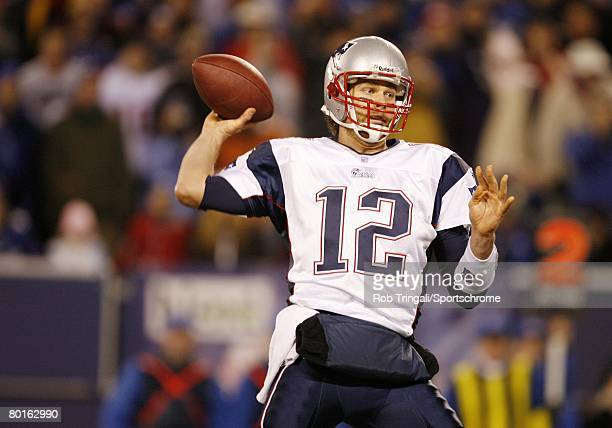 Tom Brady of the New England Patriots passes against the New York Giants during their game on December 29 2007 at Giants Stadium in East Rutherford...