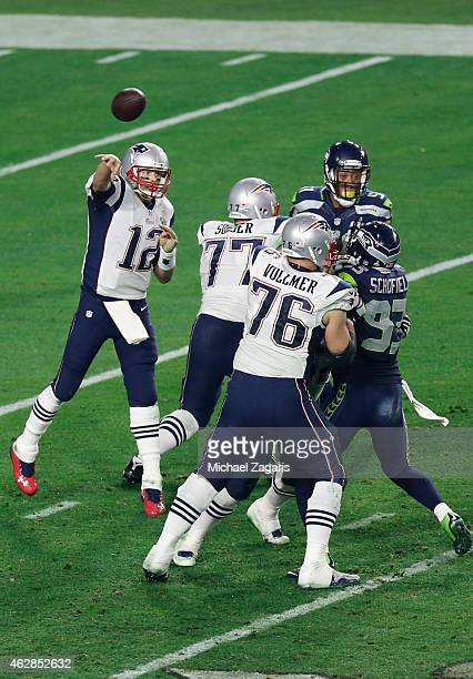 Tom Brady of the New England Patriots passes as Nate Solder and Sebastian Vollmer block during the game against the Seattle Seahawks at the...