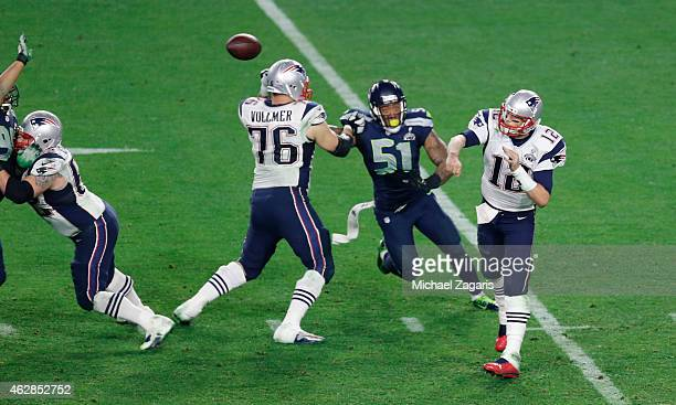 Tom Brady of the New England Patriots passes as Sebastian Vollmer block Bruce Irvin of the Seattle Seahawks during the game at the University of...