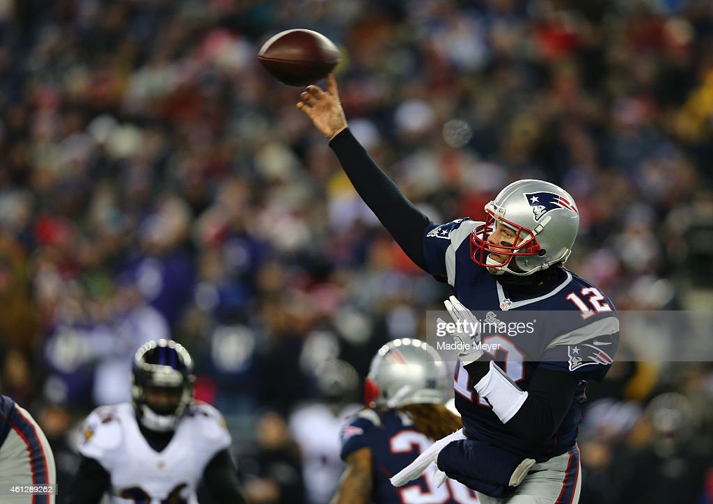 Tom Brady #12 of the New England Patriots passes in the first half against the Baltimore Ravens during the 2014 AFC Divisional Playoffs game at Gillette Stadium on January 10, 2015 in Foxboro, Massachusetts.