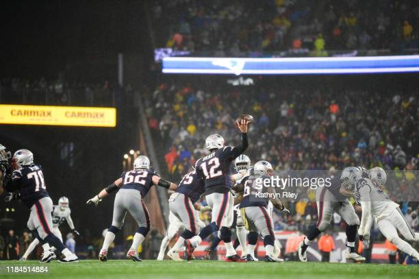 Tom Brady of the New England Patriots passes in the fourth quarter against the Dallas Cowboys during the game at Gillette Stadium on November 24 2019...