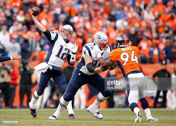 Tom Brady of the New England Patriots passes in the third quarter against the Denver Broncos in the AFC Championship game at Sports Authority Field...