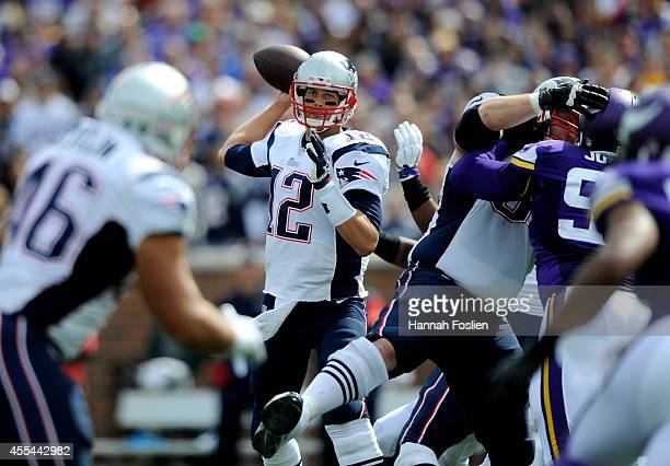 Tom Brady of the New England Patriots passes the football during the second quarter of the game against the Minnesota Vikings on September 14 2014 at...