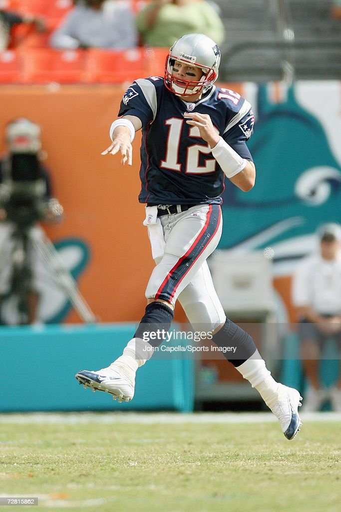 Tom Brady #12 of the New England Patriots passing in a game against the Miami Dolphins at Dolphin Stadium on December 10, 2006 in Miami, Florida. The Dolphins defeated the Patriots 21-0.