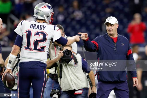 Tom Brady of the New England Patriots points to head coach Bill O'Brien of the Houston Texans prior to the game at NRG Stadium on December 01 2019 in...