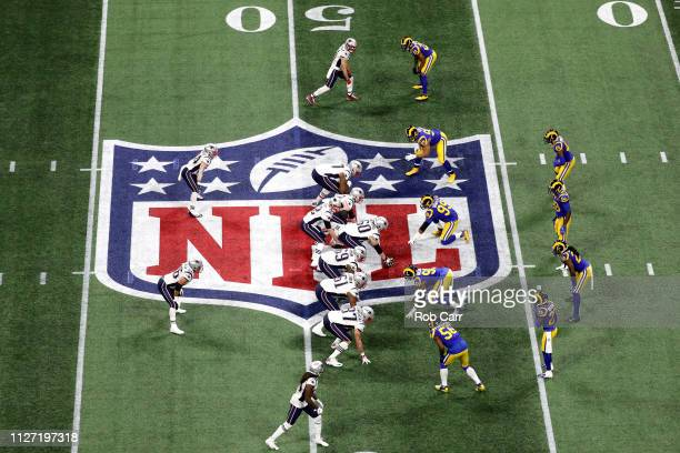 Tom Brady of the New England Patriots prepares to run the play against the Los Angeles Rams during the first quarter during Super Bowl LIII at...