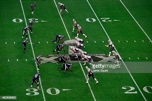 Tom Brady of the New England Patriots prepares to take a snap in the first quarter against the Seattle Seahawks during Super Bowl XLIX at University...