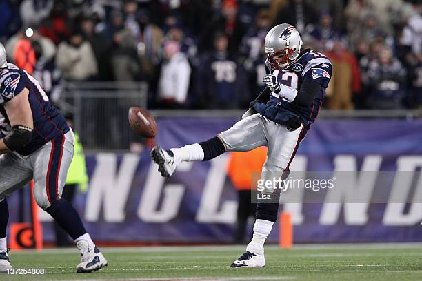 Tom Brady of the New England Patriots punts against the Denver Broncos during their AFC Divisional Playoff Game at Gillette Stadium on January 14...