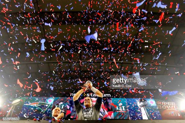 Tom Brady of the New England Patriots raises the Vince Lombardi Trophy after defeating the Atlanta Falcons during Super Bowl 51 at NRG Stadium on...