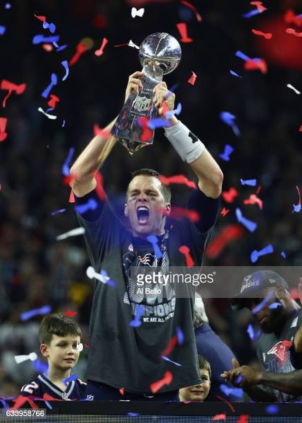 Tom Brady of the New England Patriots raises the Vince Lombardi trophy after the Patriots defeat the Atlanta Falcons in overtime of Super Bowl 51 at...