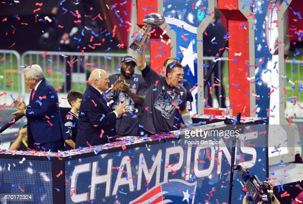 Tom Brady of the New England Patriots raises the Vince Lombardi trophy after the Patriots defeat the Atlanta Falcons 3428 in overtime of Super Bowl...