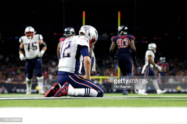 Tom Brady of the New England Patriots reacts after a play against the Houston Texans during the third quarter in the game at NRG Stadium on December...