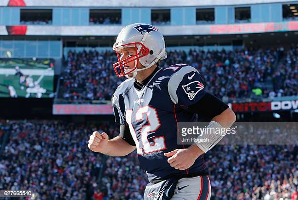 Tom Brady of the New England Patriots reacts after a rushing touchdown by LeGarrette Blount during the first quarter against the Los Angeles Rams at...