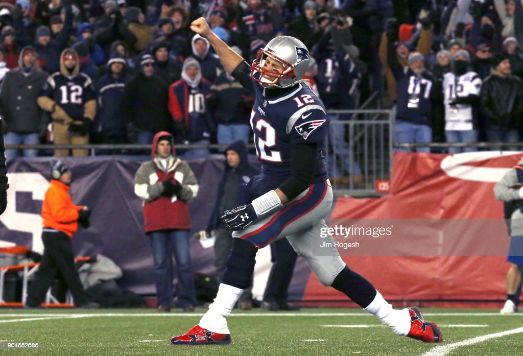 Tom Brady #12 of the New England Patriots reacts after a touchdown in the third quarter of the AFC Divisional Playoff game against the Tennessee Titans at Gillette Stadium on January 13, 2018 in Foxborough, Massachusetts.