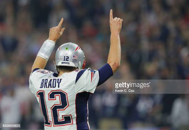 Tom Brady of the New England Patriots reacts after a touchdown late in the fourth quarter against the Atlanta Falcons during Super Bowl 51 at NRG...