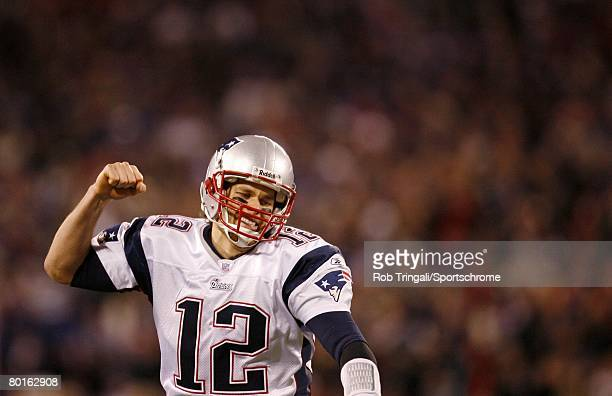 Tom Brady of the New England Patriots reacts after a touchdown against the New York Giants during their game on December 29 2007 at Giants Stadium in...