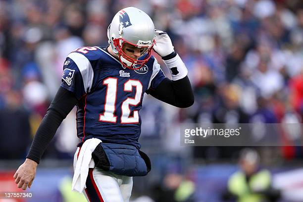 Tom Brady of the New England Patriots reacts after an interception by Lardarius Webb of the Baltimore Ravens in the first quarter during their AFC...