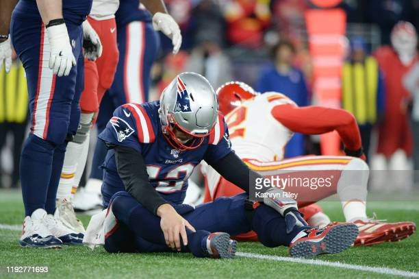 Tom Brady of the New England Patriots reacts after being knocked down during the second half against the Kansas City Chiefs in the game at Gillette...