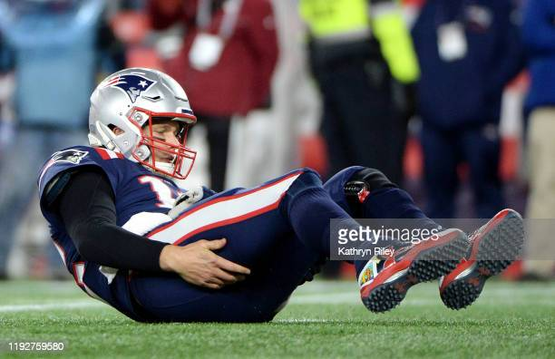 Tom Brady of the New England Patriots reacts after being sacked during the second half against the Kansas City Chiefs in the game at Gillette Stadium...