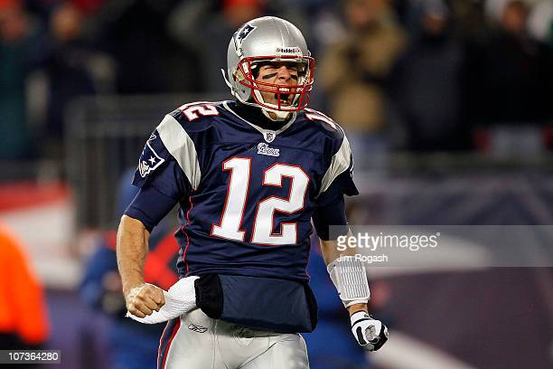 Tom Brady of the New England Patriots reacts after BenJarvus GreenEllis scored a 1yard rushing touchdown in the first quarter against the New York...