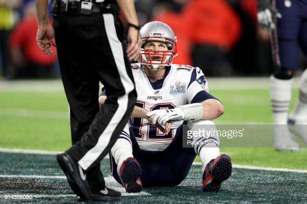 Tom Brady of the New England Patriots reacts after fumbling against the Philadelphia Eagles during the fourth quarter in Super Bowl LII at US Bank...