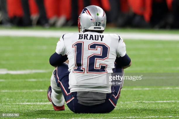 Tom Brady of the New England Patriots reacts after fumbling the ball during the fourth quarter against the Philadelphia Eagles in Super Bowl LII at...