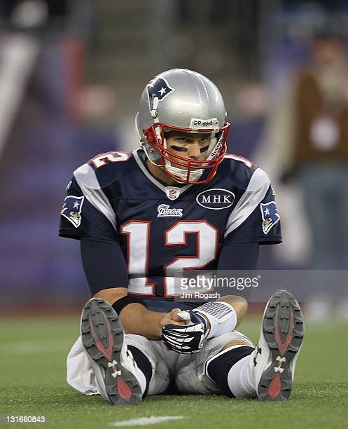 Tom Brady of the New England Patriots reacts after getting knock down during a game with the New York Giants in the first half at Gillette Stadium on...