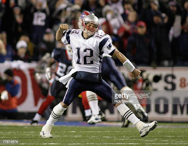 Tom Brady of the New England Patriots reacts after Lawrence Maroney scored New England's first touchdown against the Buffalo Bills at Ralph Wilson...
