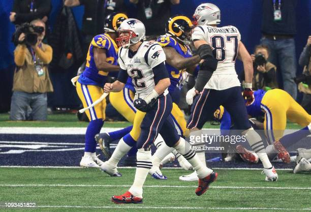 Tom Brady of the New England Patriots reacts after the New England Patriots score a touchdown in the fourth quarter during Super Bowl LIII against...