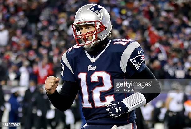 Tom Brady of the New England Patriots reacts after throwing a touchdown pass during the fourth quarter of the 2015 AFC Divisional Playoffs game...