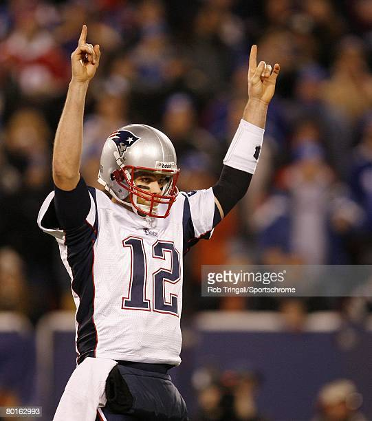 Tom Brady of the New England Patriots reacts after throwing a touchdown pass against the New York Giants during their game on December 29 2007 at...