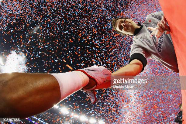 Tom Brady of the New England Patriots reacts after winning the AFC Championship Game against the Jacksonville Jaguars at Gillette Stadium on January...