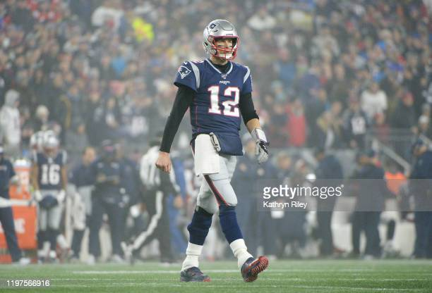 Tom Brady of the New England Patriots reacts against the Tennessee Titans in the first half of the AFC Wild Card Playoff game at Gillette Stadium on...