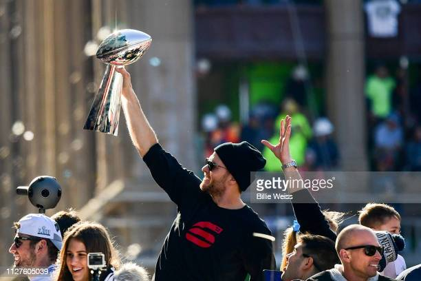 Tom Brady of the New England Patriots reacts as he holds the Vince Lombardi trophy during the Super Bowl Victory Parade on February 05, 2019 in...