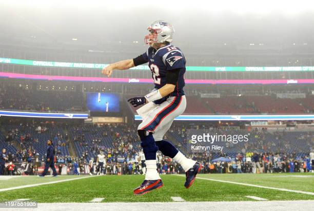 Tom Brady of the New England Patriots reacts as he runs onto the field before the AFC Wild Card Playoff game against the Tennessee Titans at Gillette...