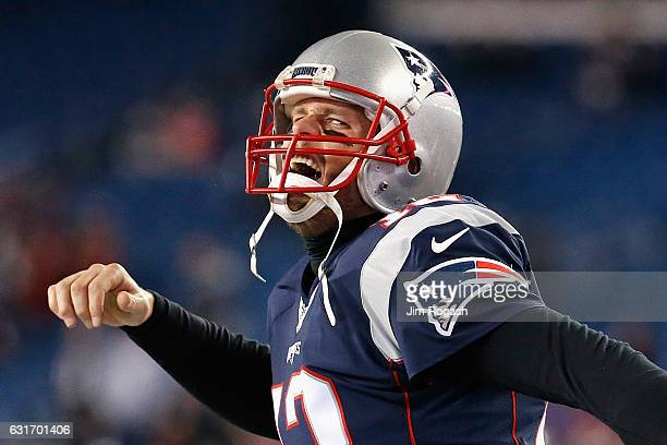 Tom Brady of the New England Patriots reacts as he runs onto the field prior to the AFC Divisional Playoff Game against the Houston Texans at...