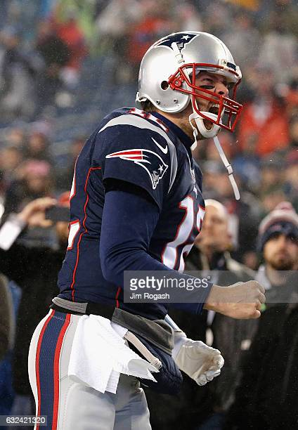 Tom Brady of the New England Patriots reacts as he runs onto the field prior to the AFC Championship Game against the Pittsburgh Steelers at Gillette...