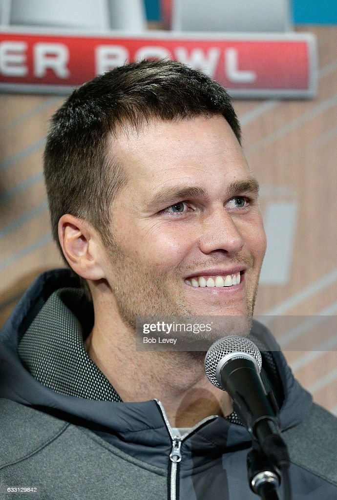 Tom Brady #12 of the New England Patriots reacts as he speaks with the media during Super Bowl 51 Opening Night at Minute Maid Park on January 30, 2017 in Houston, Texas.