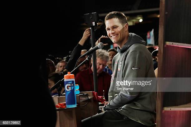 Tom Brady of the New England Patriots reacts as he speaks with the media during Super Bowl 51 Opening Night at Minute Maid Park on January 30 2017 in...