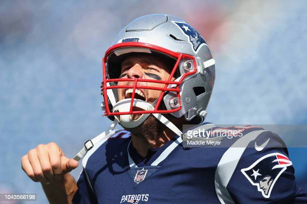Tom Brady of the New England Patriots reacts as he takes the field before the game against the Miami Dolphins at Gillette Stadium on September 30...