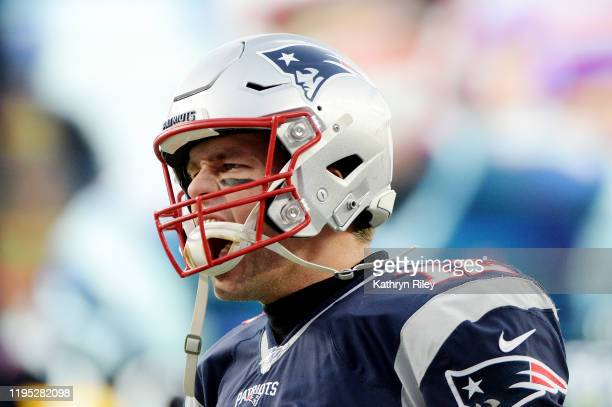 Tom Brady of the New England Patriots reacts as he takes the field before the game against the Buffalo Bills at Gillette Stadium on December 21 2019...