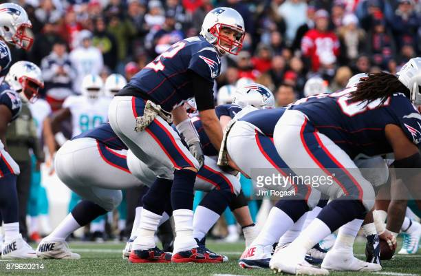 Tom Brady of the New England Patriots reacts at the line of scrimmage during the first quarter of a game against the Miami Dolphins at Gillette...