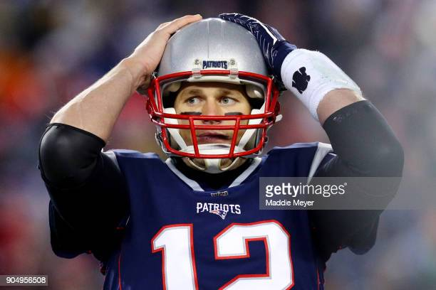 Tom Brady of the New England Patriots reacts during the AFC Divisional Playoff game against the Tennessee Titans at Gillette Stadium on January 13...