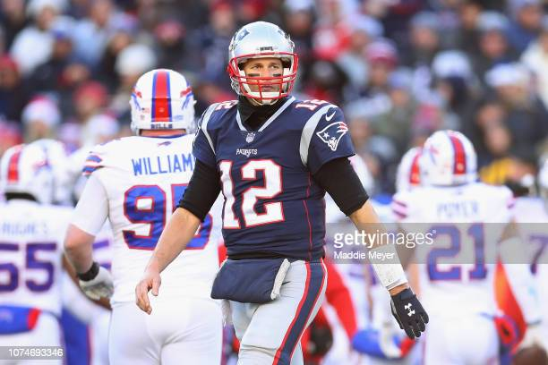 Tom Brady of the New England Patriots reacts during the first half against the Buffalo Bills at Gillette Stadium on December 23 2018 in Foxborough...