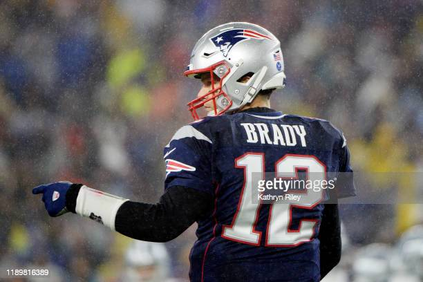 Tom Brady of the New England Patriots reacts during the first half against the Dallas Cowboys in the game at Gillette Stadium on November 24 2019 in...